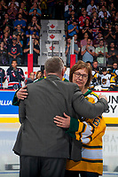 REGINA, SK - MAY 25: Humboldt Broncos president Kevin Garinger hugs Carol Borns, the mother of the late Dayna Borns, athletic therapist of the Humboldt Broncos at the Brandt Centre on May 25, 2018 in Regina, Canada. (Photo by Marissa Baecker/CHL Images)