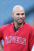 ANAHEIM, CA - APRIL 15:  Albert Pujols #5 of the Los Angeles Angels of Anaheim smiles during batting practice before the game against the Oakland Athletics at Angel Stadium on Tuesday, April 15, 2014 in Anaheim, California. The Athletics won the game 10-9 in eleven innings. (Photo by Paul Spinelli/MLB Photos via Getty Images) *** Local Caption *** Albert Pujols