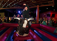 Colleen takes a round with the Mechanical Bull with Jodie Cunningham Band on stage Saturday night during opening weekend at the Whiskey Barrel in downtown Laconia.  (Karen Bobotas/for the Laconia Daily Sun)