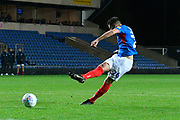 Gareth Evans (26) of Portsmouth takes a penalty during the shoot out at full time after a 2-2 draw during the Leasing.com EFL Trophy match between Oxford United and Portsmouth at the Kassam Stadium, Oxford, England on 8 October 2019.