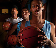 At Burbank High School gym, Foreground, Emmanuel, Remle and Malik, background stand during a practice at the school. For the first time in organzied basketball the Pope brothers - Malik, Remle and Emmanuel - are playing together on the same Burbank boys team. The 6-foot-6 (or so) trio hope to lead Burbank to a Sac-Joaquin Section title and make their bigger rooter, mother Nicole, proud. January 27, 2012..