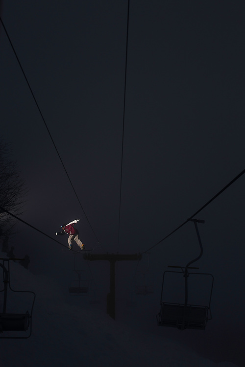 2010 Olympic Bronze medalist Scotty Lago, backside lipslides the cable of a moving chairlift at a ski resort in Chile.