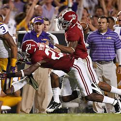 November 3, 2012; Baton Rouge, LA, USA;  LSU Tigers wide receiver Odell Beckham (3) runs away from Alabama Crimson Tide defensive back Nick Perry (27) during a game at Tiger Stadium. Alabama defeated LSU 21-17. Mandatory Credit: Derick E. Hingle-US PRESSWIRE