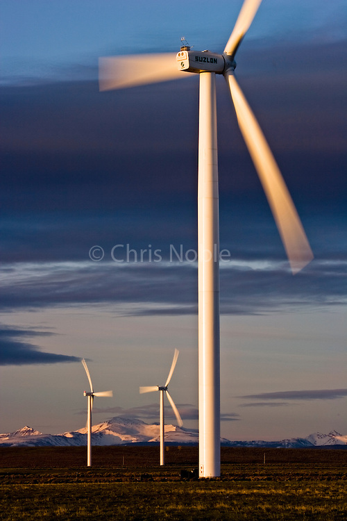 Wind turbines and the High Uinta Mountains at a wind farm in Southern Wyoming.