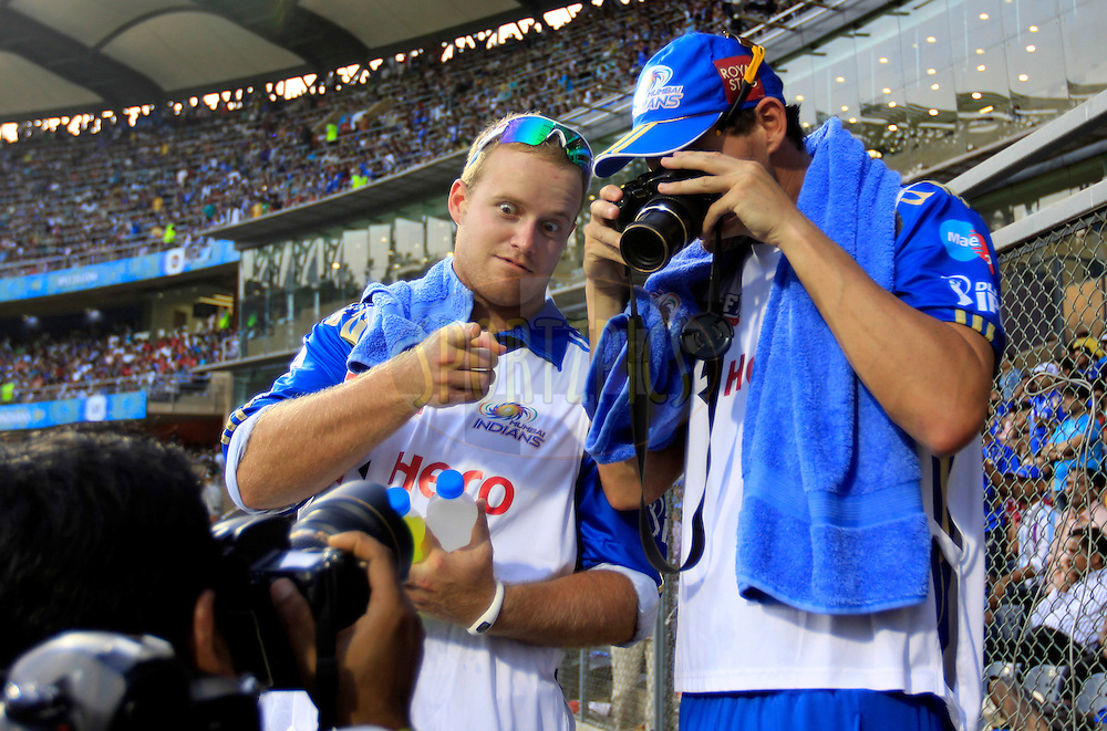 Mumbai Indian player Clint McKay takes photographs as Mumbai Indian player Richard Levi looks  during match 28 of the Indian Premier League ( IPL) 2012  between The Mumbai Indians and the Kings X1 Punjab held at the Wankhede Stadium in Mumbai on the 22nd April 2012..Photo by: Vipin Pawar/IPL/SPORTZPICS