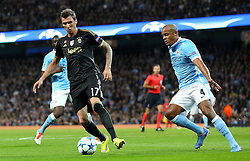 Mario Mandzukic of Juventus is closed down by Manchester City captain, Vincent Company during the UEFA Champions League group stage match between Manchester City and Juventus at the Etihad Stadium - Mandatory byline: Matt McNulty/JMP - 07966386802 - 15/09/2015 - FOOTBALL - Etihad Stadium -Manchester,England - Manchester City v Juventus - UEFA Champions League - Group D