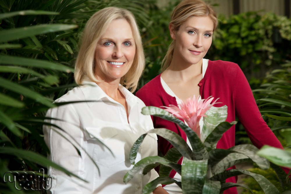 Portrait of a young daughter with senior mother in botanical garden