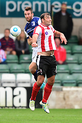 Lincoln City's Matt Rhead vies for possession with Barrow's Danny Livesey<br /> <br /> Picture: Chris Vaughan/Chris Vaughan Photography<br /> <br /> Football - Vanarama National League - Lincoln City Vs Barrow - Saturday 17th September 2016 - Sincil Bank - Lincoln<br /> <br /> Copyright © 2016 Chris Vaughan Photography. All rights reserved. Unit 11, Churchill Business Park, Bracebridge Heath, Lincoln, LN4 2FF - Telephone: 07764170783 - info@chrisvaughanphotography.co.uk - www.chrisvaughanphotography.co.uk