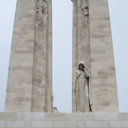 The twin white pylons of the ‪Canadian National Vimy Memorial‬ dedicated to the memory of Canadian Expeditionary Force members killed in World War one. At the front is a a figure of a weeping woman or better known as Mother Canada mourning her dead.   The monument is situated at a 100 hectare preserved battlefield with wartime tunnels, trenches, craters and unexploded munitions. The memorial designed by Walter Seymour Allward opened in 1936.