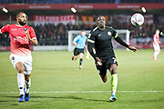 Macclesfield Town forward Arthur Gnahoua runs for the ball during the EFL Sky Bet League 2 match between Salford City and Macclesfield Town at the Peninsula Stadium, Salford, United Kingdom on 23 November 2019.