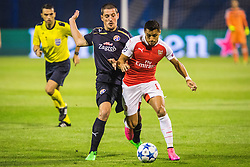 Arijan Ademi #16 of GNK Dinamo Zagreb vs Alexis Sanchez #17 of Arsenal F.C. during football match between GNK Dinamo Zagreb, CRO and Arsenal FC, ENG in Group F of Group Stage of UEFA Champions League 2015/16, on September 16, 2015 in Stadium Maksimir, Zagreb, Croatia. Photo by Ziga Zupan / Sportida