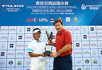 Sir Nick Faldo and Masamichi Ito of Japan pose with the trophy during the third day of the Faldo Series Grand Final 2012 at the Faldo Course at Mission Hills Golf Club in Shenzhen, China. Photo by Manuel Queimadelos / The Power of Sport Images