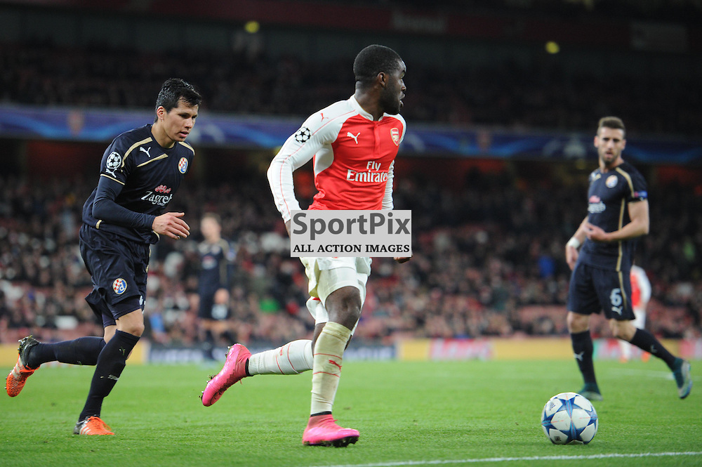 Arsenals Joel Campbell and Dinamo Zagrebs Leonardo Sigali in action during the Arsenal v Dinamo Zagreb game in the UEFA Champions League on the 24th November 2015 at the Emirates Stadium.