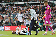 Derby County forward Tom Lawrence (10) lies injured and in pain during the EFL Sky Bet Championship match between Derby County and Swansea City at the Pride Park, Derby, England on 10 August 2019.