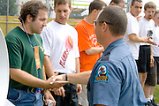 Policeman congratulating ribbon winner. Special Olympics U of M Bierman Athletic Complex. Minneapolis Minnesota USA