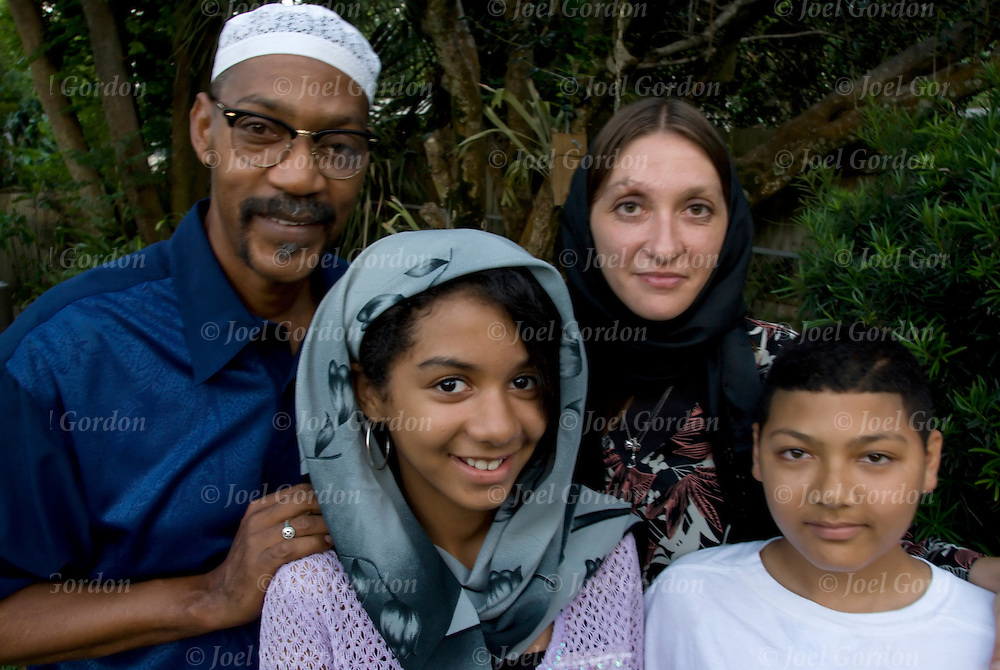 Family portrait of Muslim American Family in back yard of their home in Orlando Florida.<br /> <br /> release # 3439, 3440