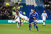 Nathan Baker of Aston Villa beats Kenneth Zohore of Cardiff City to the ball during the EFL Sky Bet Championship match between Cardiff City and Aston Villa at the Cardiff City Stadium, Cardiff, Wales on 2 January 2017. Photo by Andrew Lewis.
