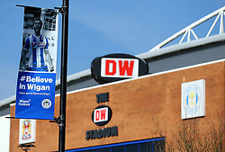 A general view of The DW Stadium, home of Wigan Athletic, with a poster of Will Grigg of Wigan Athletic outside the ground - Mandatory by-line: Robbie Stephenson/JMP - 24/02/2018 - FOOTBALL - DW Stadium - Wigan, England - Wigan Athletic v Rochdale - Sky Bet League One