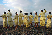 The festival of Janamashtami or Gokul Ashtami, the birth of Lord Krishna, being celebrated in Mumbai. A group of young devotees come early in the moring to Chowpatty Beach before starting their prayers.