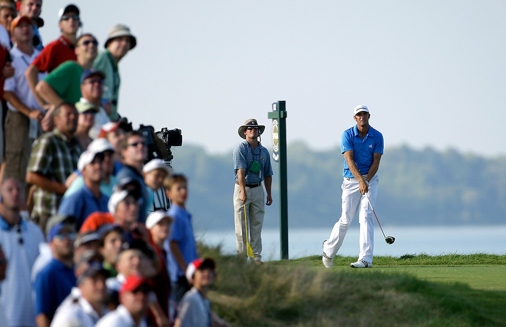 pga15, spt, lynn, 26.-Dustin Johnson follows through on his tee shot on the16th hole during the third round of action at  Whistling Straits in Haven, WI Saturday August 14, 2010.  Photo by Tom Lynn/TLYNN@JOURNALSENTINEL.COM