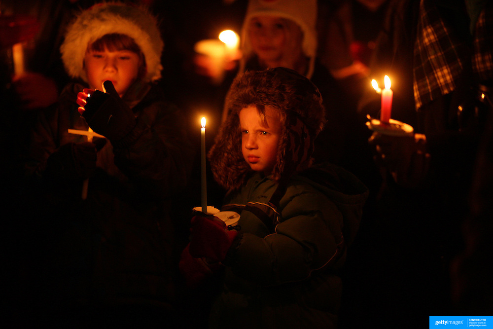 Young children at a townwide community candlelight  vigil on Sherman Green. Fairfield, Connecticut after the mass shootings at Sandy Hook Elementary School, Newtown, Connecticut, USA. 17th December 2012. Photo Tim Clayton