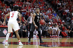 20 March 2017:  B.J. Taylor works half court met by Keyshawn Evans(3) during a College NIT (National Invitational Tournament) 2nd round mens basketball game between the UCF (University of Central Florida) Knights and Illinois State Redbirds in  Redbird Arena, Normal IL