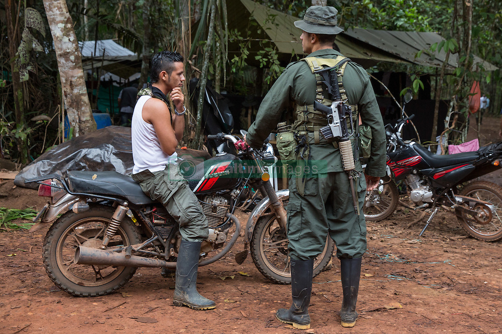 El Diamante, Meta, Colombia - 19.09.2016        <br /> <br /> Guerilla camp during the 10th conference of the marxist FARC-EP in El Diamante, a Guerilla controlled area in the Colombian district Meta. Few days ahead of the peace contract passing after 52 years of war with the Colombian Governement wants the FARC decide on the 7-days long conferce their transformation into a unarmed political organization. <br /> <br /> Guerilla-Camp zur zehnten Konferenz der marxistischen FARC-EP in El Diamante, einem von der Guerilla kontrollierten Gebiet in der kolumbianischen Region Meta. Wenige Tage vor der geplanten Verabschiedung eines Friedensvertrags nach 52 Jahren Krieg mit der kolumbianischen Regierung will die FARC auf ihrer sieben taegigen Konferenz die Umwandlung in eine unbewaffneten politischen Organisation beschlieflen. <br />  <br /> Photo: Bjoern Kietzmann