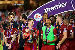 HONG KONG, CHINA - Saturday, July 22, 2017: Liverpool's Ben Woodburn lifts the trophy as Trent Alexander-Arnold looks on during the Premier League Asia Trophy final match between Liverpool and Leicester City at the Hong Kong International Stadium. (Pic by David Rawcliffe/Propaganda)