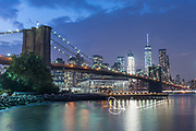 Brooklyn Bridge and downtown Manhattan lit up at night, New York City.