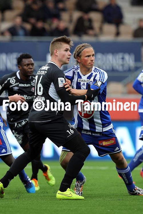19.4.2015, Sonera stadion, Helsinki.<br /> Veikkausliiga 2015.<br /> Helsingin Jalkapalloklubi - FC Lahti..<br /> Henri Toivom&auml;ki (FC Lahti) v Tapio Heikkil&auml; (HJK).
