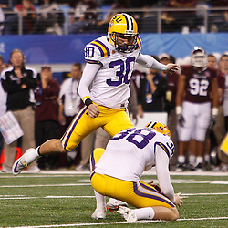 Jan 7, 2011; Arlington, TX, USA; LSU Tigers kicker Josh Jasper (30) kicks a field goal during the second quarter of the 2011 Cotton Bowl against the Texas A&M Aggies at Cowboys Stadium.  Mandatory Credit: Derick E. Hingle