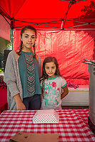 """""""I've been working helping at this booth for 13 years.""""  -Sixteen year old Citlalli Garcia sells home made Tamales with help from her seven year old cousin, Sofia, at the Calistoga Saturday Market"""