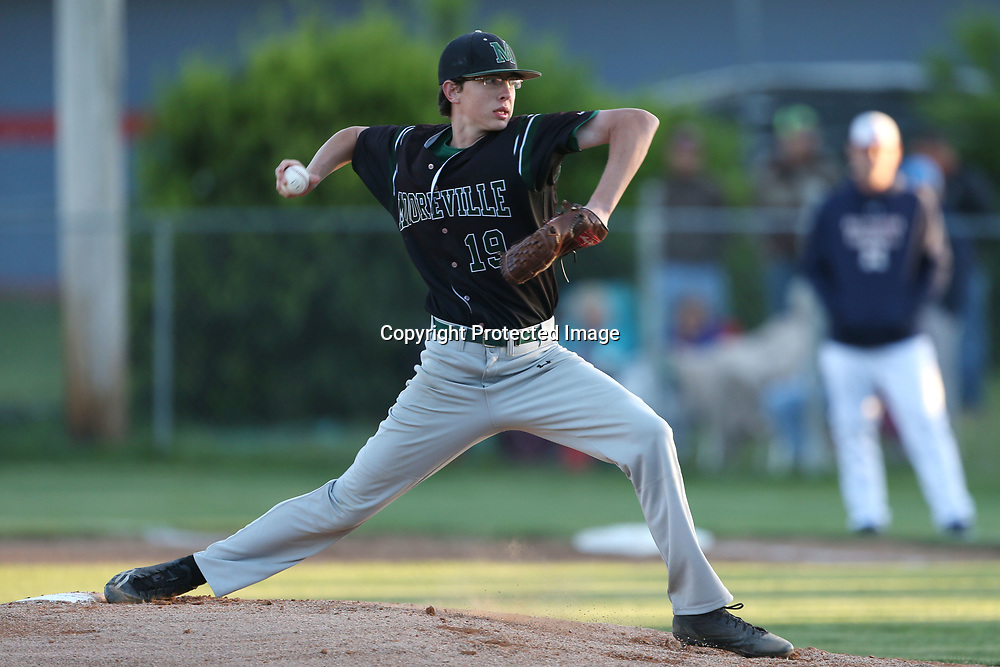 Mooreville's Will Armistead pitches from the mound during Friday night's playoff game at Nettleton.