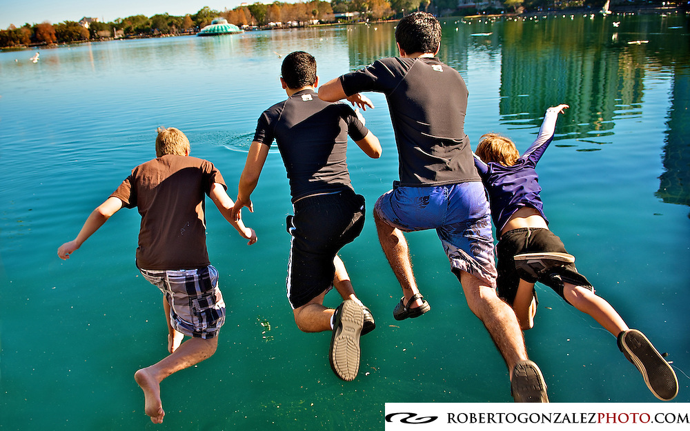 Young men from St. George Antiochian Orthodox Church jump into Lake Eola to retrieve a cross as part of the celebration of Epiphany, Orlando, Sunday, January 8, 2012. Epiphany marks the end of the Christmas season. (For the Orlando Sentinel/Roberto Gonzalez)