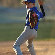A young baseball player fields the ball during the Norwalk Little League baseball competition at Broad River Fields,  Norwalk, Connecticut. USA. Photo Tim Clayton