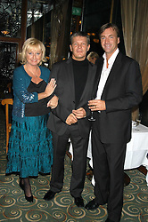 Left to right, TV presenter JUDY FINNEGAN, RUSS LINDSAY husband of the late Caron Keating and RICHARD MADLEY at a party to celebrate the publication of 'Next To You' - Caron's Courage remembered by her mother Gloria Hunniford held on Caron's birthday at The Hilton Park Lane, London on 5th Octobe 2005.<br /><br />NON EXCLUSIVE - WORLD RIGHTS