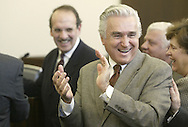Rep. Maurice Hinchey laughs after a slight scissors malfunction at the end of the grand opening of the U.S. District Courthouse in Middletown on Monday, Jan. 12, 2009.