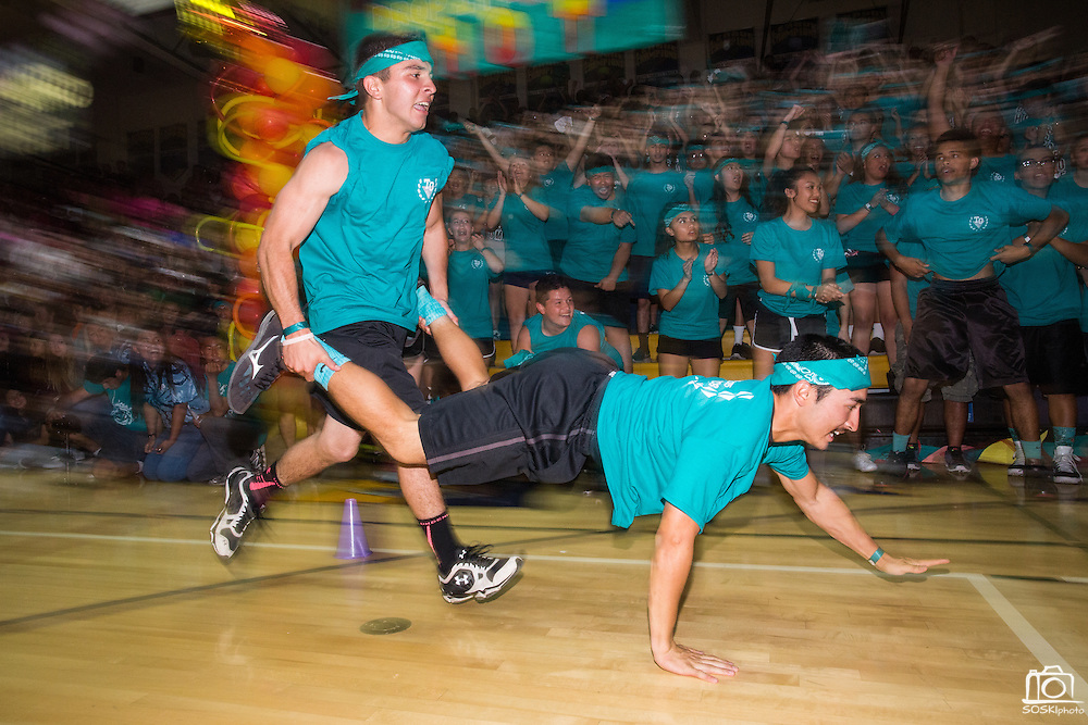 The Junior class competes in the wheelbarrow race during the annual Trojan Olympics, where students compete in various unorthodox events for class bragging rights, at Milpitas High School in Milpitas, California, on March 27, 2015. (Stan Olszewski/SOSKIphoto)