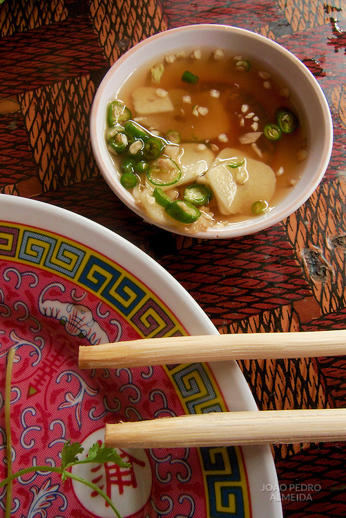 Small side plate with sauce with chopsticks