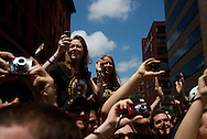 June 18, 2011, Boston, MA - Fans who could not get to the very front of the crowd sit on people's shoulders to get a glimpse of the parade. Photo by Lathan Goumas.