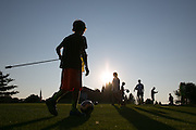 Soccer players and their parents enjoy a round of foot golf at Victor Hills Golf Club in Victor on Monday, July 27, 2015. The game is played on golf courses, and requires players to kick a soccer ball into a large hole.