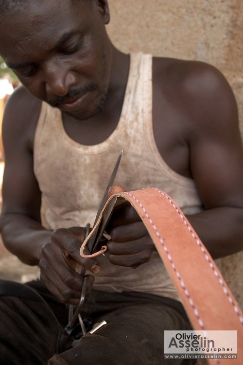 Man making leather belt in Tamale, Northern Ghana.