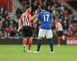 Southampton's Shane Long confronts Everton's Muhamed Besic - Photo mandatory by-line: Alex James/JMP - Mobile: 07966 386802 - 20/12/2014 - SPORT - Football - Southampton  - St Mary's Stadium - Southampton  v Everton - Football