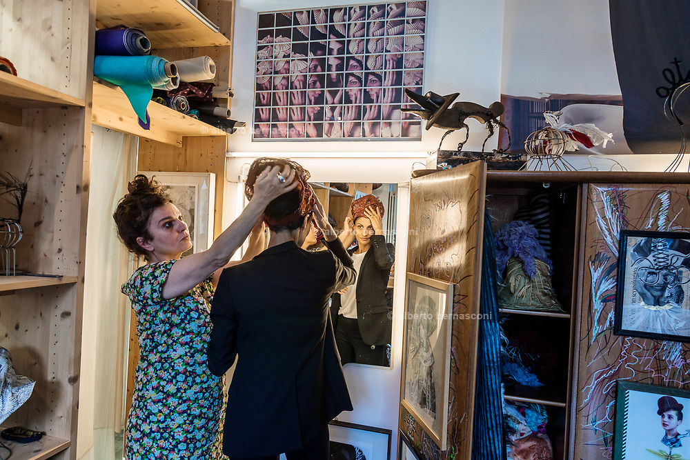 Milan, Helene Nonini trying new turbans at the Altelan atelier. http://www.altalen.it/