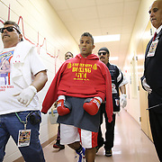 """Samuel Rodriguez walks toward his fight against Jayron Santiago during a """"Boxeo Telemundo""""  boxing match at the Kissimmee Civic Center on Friday, July 18, 2014 in Kissimmee, Florida.  (AP Photo/Alex Menendez)"""