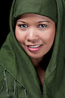 Portrait of asiatic woman of islamic religion with scarf.