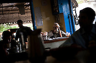 Pakistani men drink tea and eat breakfast in a teahouse, on 5 May, 2011, in Abbottabad, Pakistan. Bin Laden was killed during a U.S. military mission on May 2, at the compound.  The operation, code-named Operation Neptune Spear, was launched from neighbouring Afghanistan by Seal Team Six. U.S. forces took bin Laden's body to Afghanistan for identification, then dumped it the Arabian Sea. Pakistan has since been widely suspected as having prior knowledge of his whereabouts as the compound was less than a kilometre from the country's biggest military academy. Osama bin Laden was allegedly responsible for supporting the bombing of the US Embassy in Nairobi, Kenya, the attack on the USS Cole and the suicidal attacks of September 11, 2001 in the US. (Photo by Warrick Page)