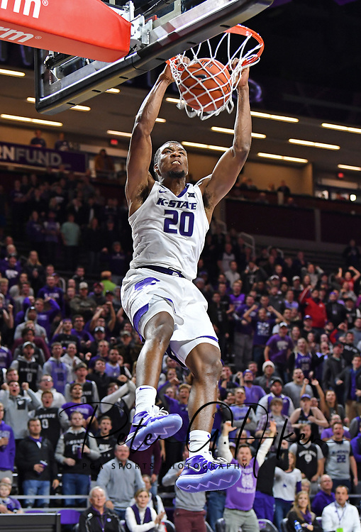 MANHATTAN, KS - NOVEMBER 12:  Xavier Sneed #20 of the Kansas State Wildcats scores with a slam dunk against the Denver Pioneers during the second half on November 12, 2018 at Bramlage Coliseum in Manhattan, Kansas.  (Photo by Peter G. Aiken/Getty Images) *** Local Caption *** Xavier Sneed