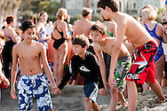 Diego Majewski, Nathan Thomson, Santiago Majewski and Zach Thomson lead the pack at the start of the Polar Plunge at La Jolla Shore Beach.