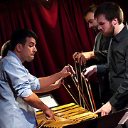 """August 4, 2013 - New York, NY : <br /> From left, Justin Wolf (in purple), Piero Guimaraes (in blue), Chris Graham, and Josh Perry of Iktus Percussion perform Elliot Cole's 'Postludes for Bowed Vibraphone (mov. 5)' during Vicky Chow's """"Contagious Sounds"""" at Cornelia Street Cafe in Manhattan on Wednesday evening.<br /> CREDIT: Karsten Moran for The New York Times"""